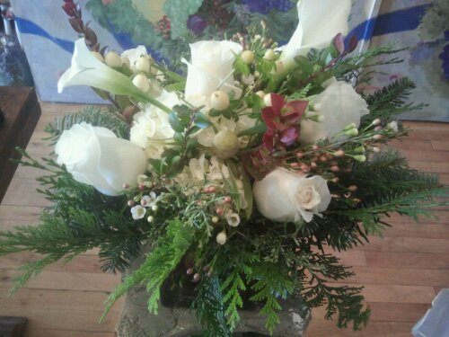 Centerpiece with mixed winter greens hydrangea hypericum berry mini calla lillies white